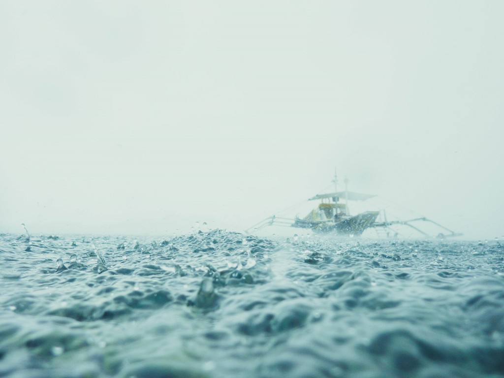 It was raining hard when we had our snorkeling in Coron's protected fish sanctuary. Taken at Coron, Palawan.