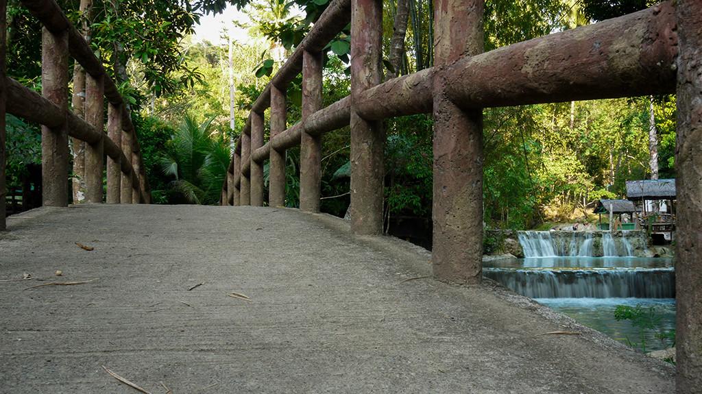Bridge over serene water.