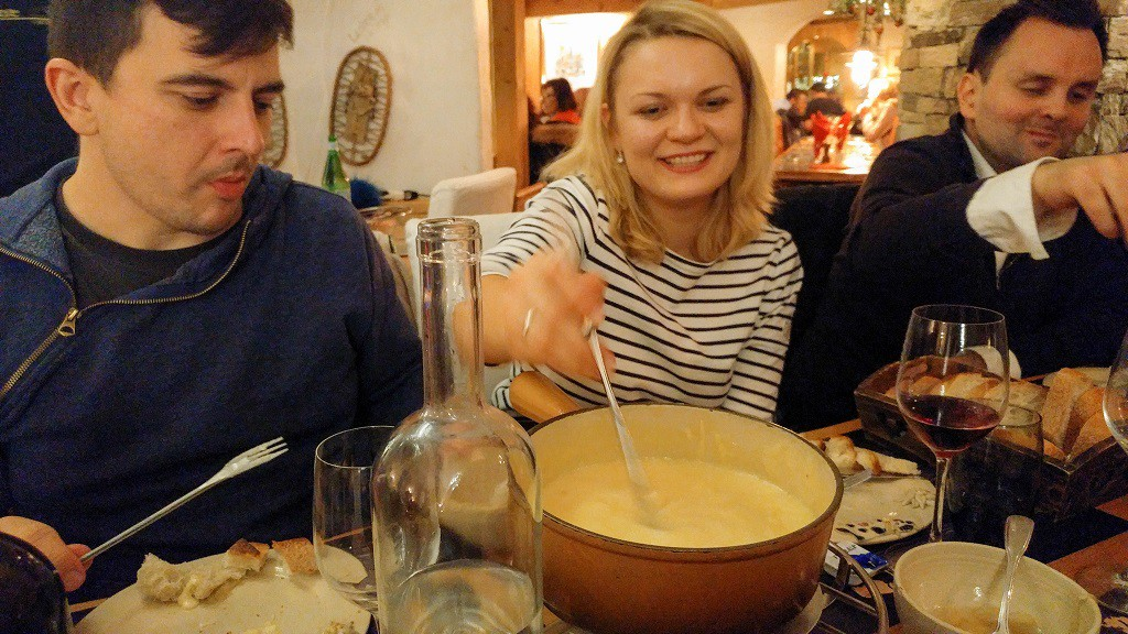 Paweł, Julia and Etienne enjoying cheese fondue. FYI: Eating cheese fondue is tricky, if you dropped your bread on it, you'll get a punishment. :D
