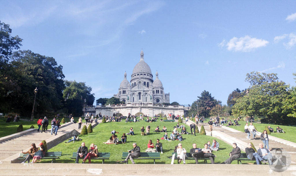 People chilling on the ground at Basilica du Sacre-Coeur de Montmartre